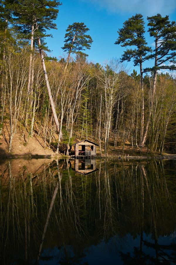 Forest lake with fisherman`s house on the shore. Karagol lake in Crimea, Ai petri road, Yalta. Forest lake with fisherman`s house on the shore. Russian nature royalty free stock photography
