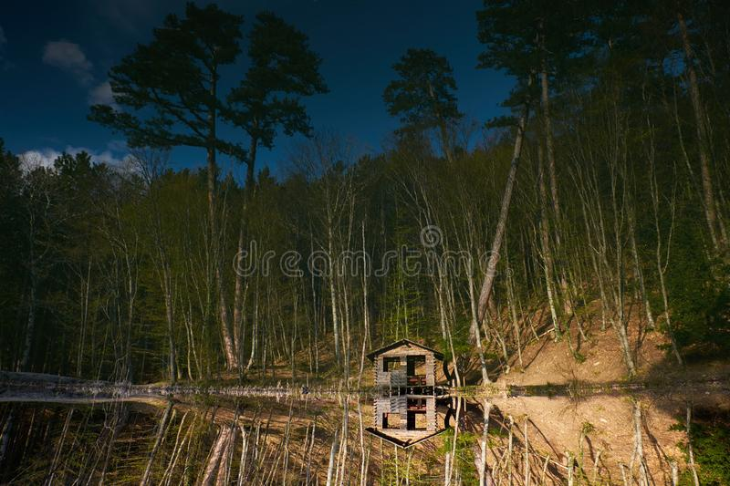Forest lake with fisherman`s house on the shore. Karagol lake in Crimea, Ai petri road, Yalta. Forest lake with fisherman`s house on the shore. Russian nature stock images