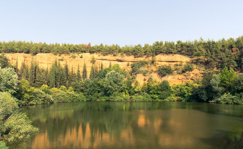 Forest lake and mountain scenery. In Thermi`s dam, Greece stock photography