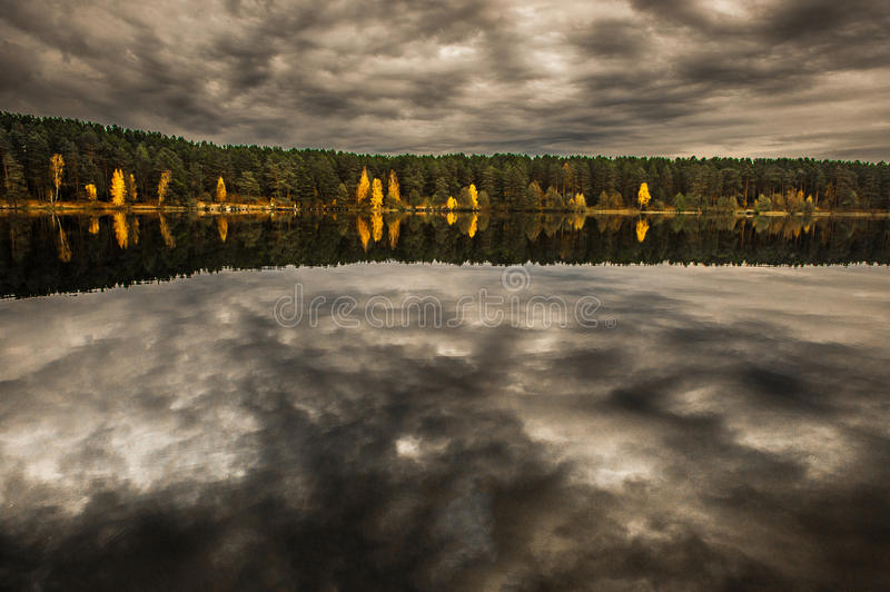 Forest and Landscape wit reflection on lake. Vilnius area, capital of Lithuania. Autumn time royalty free stock photo