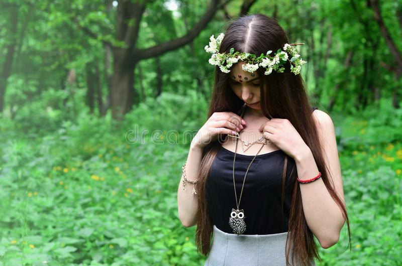 A forest picture of a beautiful young brunette of European appearance with dark brown eyes and large lips stock images