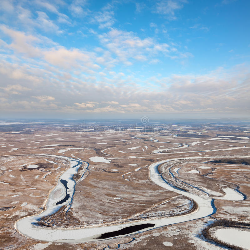 Download Forest Of Plain And Small River In Winter Stock Photo - Image: 83707749
