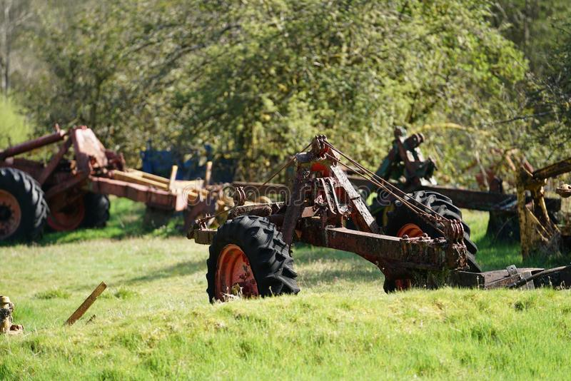Forest plough graveyard. A collection of old abandoned and derelict forest ploughs near the village of Ae, in dumfries and Galloway, south west Scotland. These stock photography