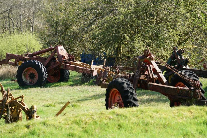 Forest plough graveyard. A collection of old abandoned and derelict forest ploughs near the village of Ae, in dumfries and Galloway, south west Scotland. These royalty free stock photography