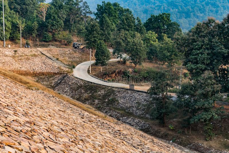 Awesome view of mountain road view passing near by water reservoir. stock photos