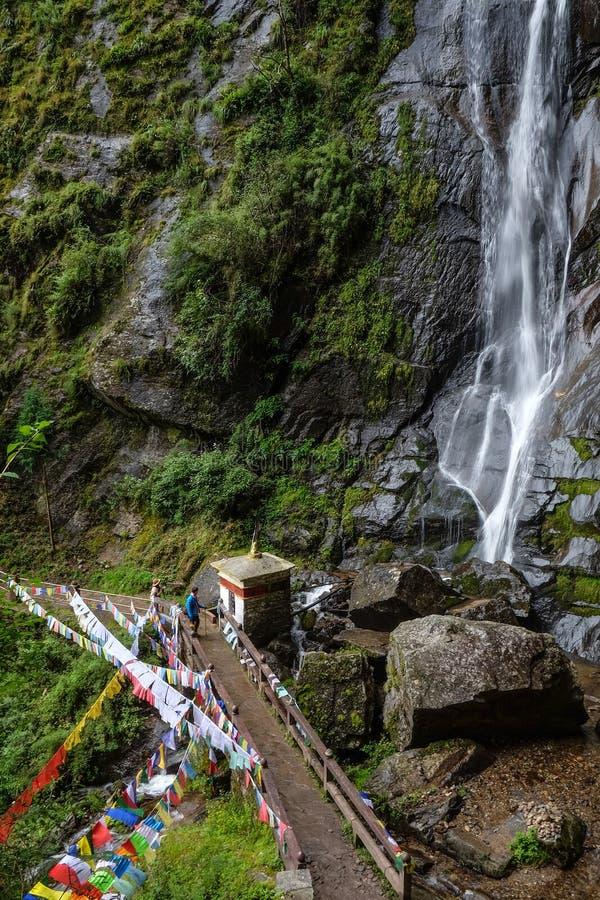 Forest trail to Taktshang Goemba. Waterfall with forest trail to Taktshang Goemba or Tiger Nest Monastery in Paro, Bhutan royalty free stock image