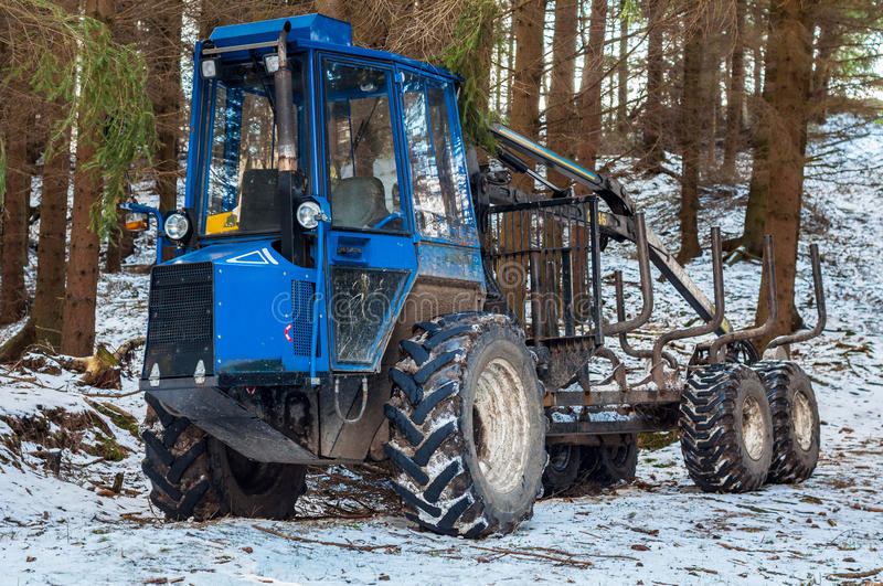 Forest tree tractor vehicle winter snow outdoor with nobody stock image