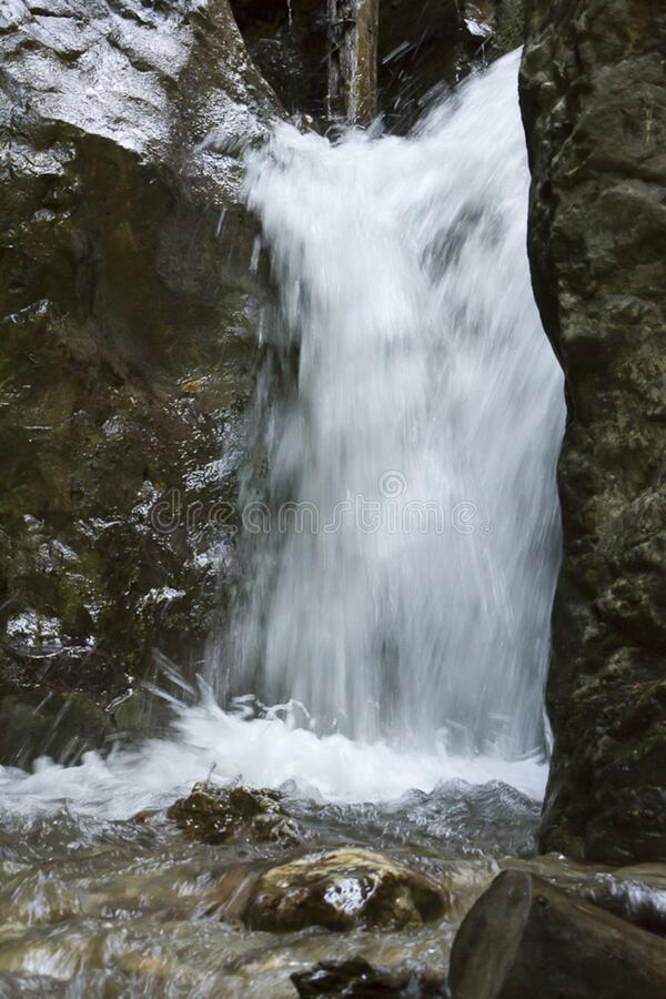 Forest waterfall blurred in slow motion capture. royalty free stock photography