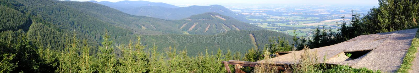 Forested Mountains and a Ramp for Paragliding. Javorovy Hill is a great place for hiking, skiing or paragliding - in this photo you can see a ramp for royalty free stock photo