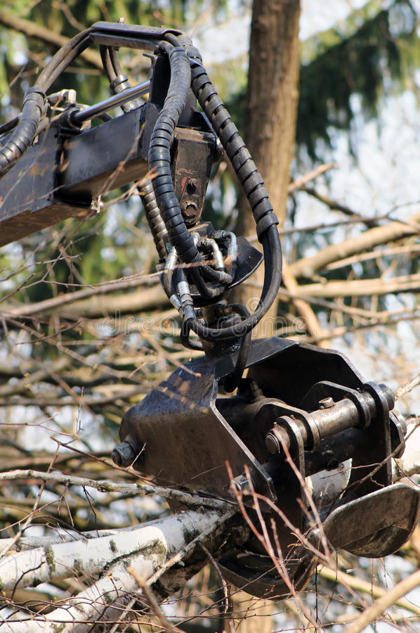 Forestry grapple. Close up of forestry grapple. Grapples are the perfect forestry attachment for tree care and landscaping applications stock photography