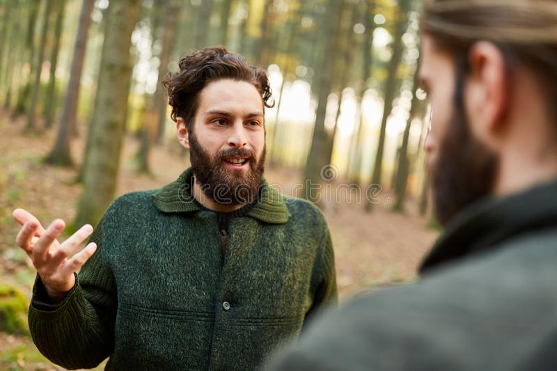 A forestry man is talking to a forest worker stock image