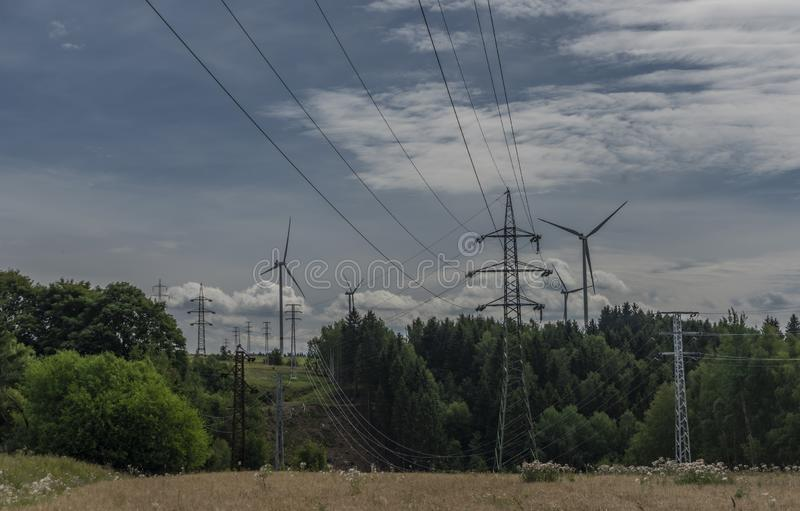 Forests and blue sky wih clouds and windy power plants and electric poles. In west Bohemia advance fan california tech breeze altamont ranch solar utility royalty free stock photo