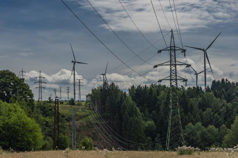 Forests and blue sky wih clouds and windy power plants and electric poles. In west Bohemia advance fan california tech breeze altamont ranch solar utility stock photos