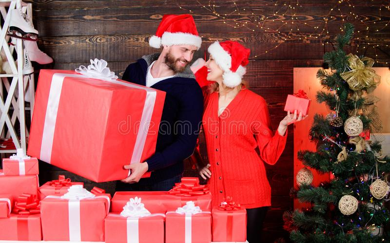 Forever love. cheerful man and woman share presents. cozy evening with your beloved. celebrate christmas together stock images