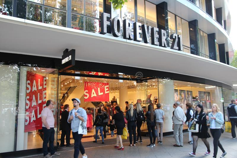 Forever 21 shop. BERLIN, GERMANY - AUGUST 27, 2014: People visit Forever 21 fashion store at Tauentzienstrasse in Berlin. There are more than 700 Forever 21 stock photography