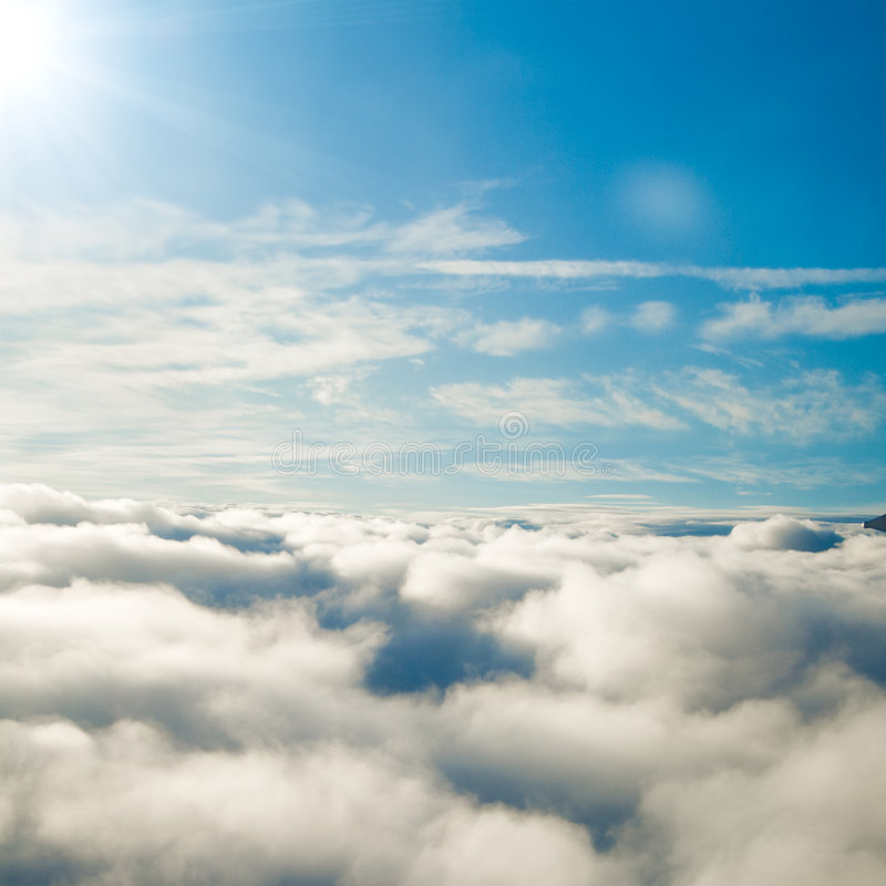 Forever sunshine above the clouds stock photo