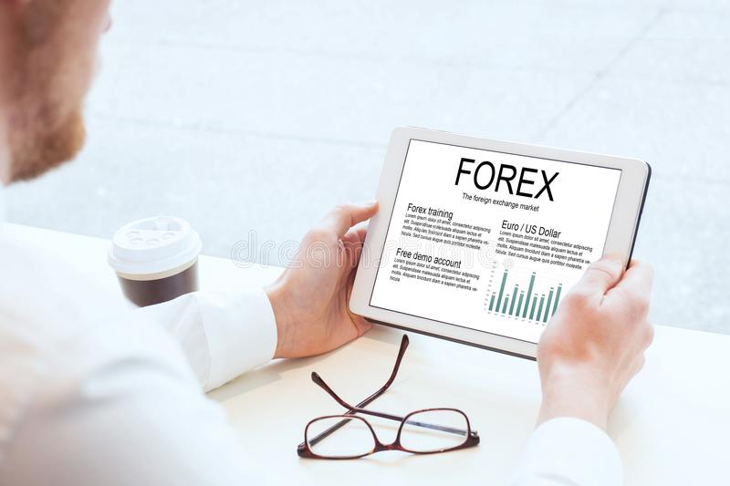Forex, businessman reading about foreign exchange market stock photo