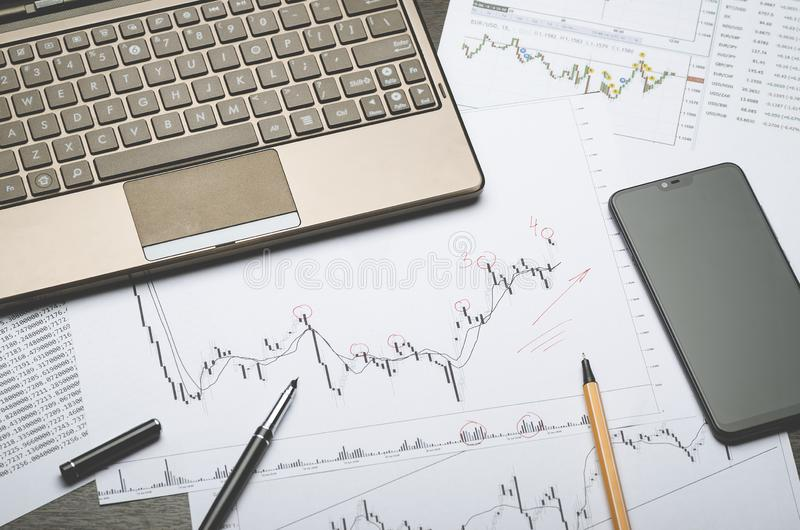 Forex charts, notebook, financial notes in Notepad stock photo