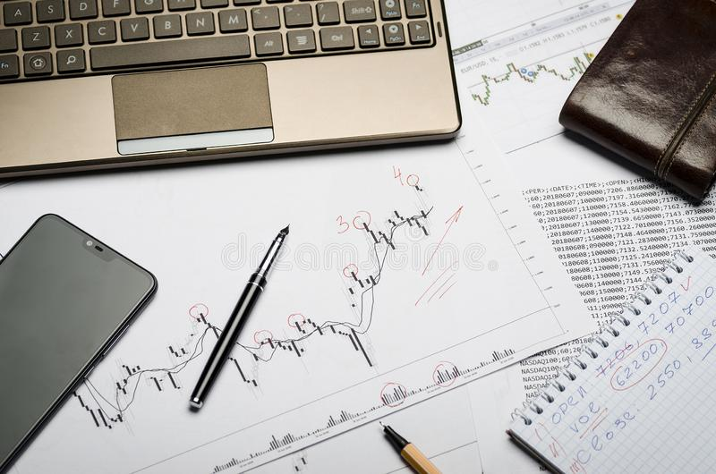 Forex charts on paper, notebook, financial notes in Notepad stock photos