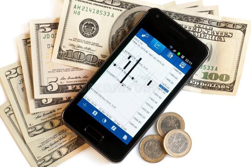 Forex che vendono dal telefono cellulare e dai soldi immagini stock