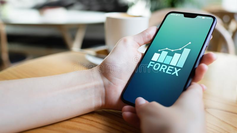 Forex effectenbeursmunt de financi?nconcept van de handelinvestering op het mobiele telefoonscherm royalty-vrije stock afbeeldingen