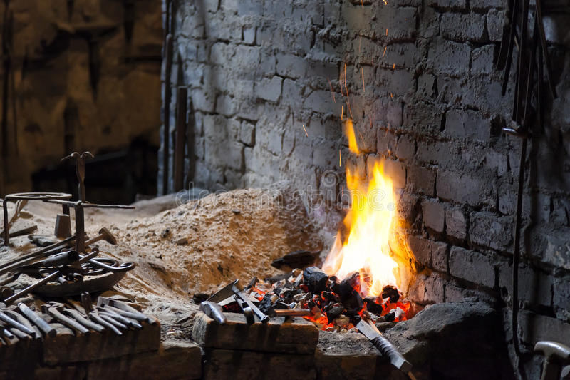 Forge with blacksmith's tools stock photos