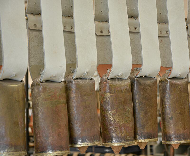 The forge, cowbell factory, craft work. Cowbells hung in forge factory royalty free stock photos