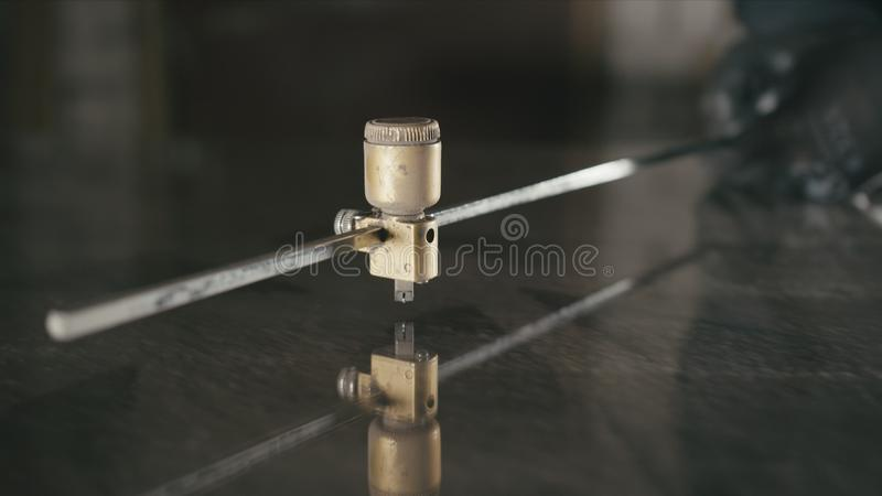 Glass cutting and processing for fireplace doors. Circular glass cutter. Worker cut glass with glass cutting diamond. Forge. Smithy. Glass cutting and royalty free stock photography