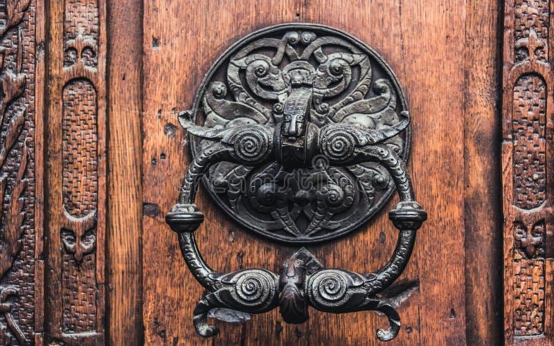 Forged Antique Doorknob. Antique door knocker royalty free stock image