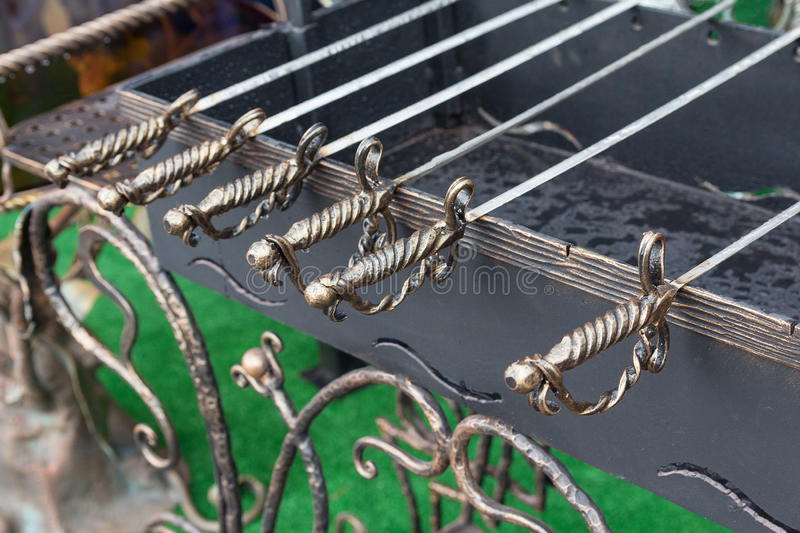 Forged barbecue skewers. Stylized as swords royalty free stock photography