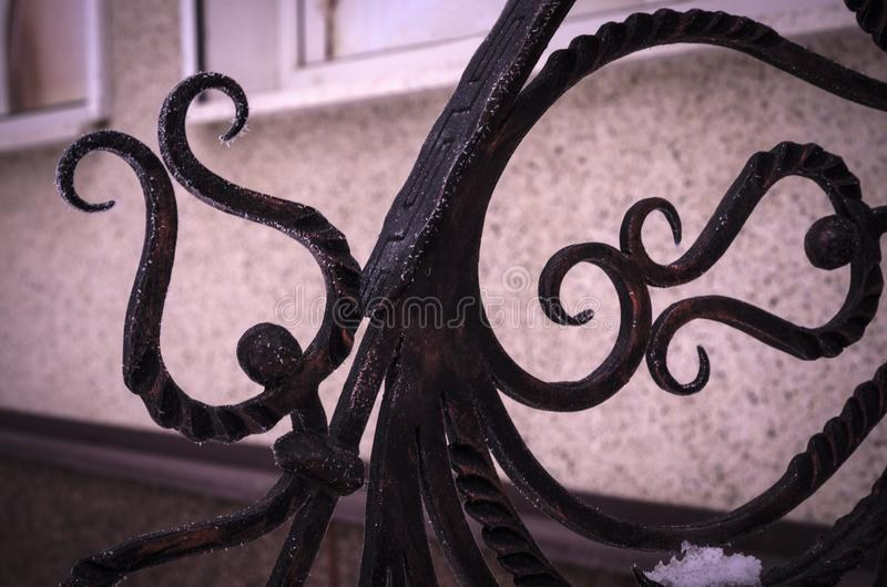 Forged elements adorning metal railing royalty free stock images