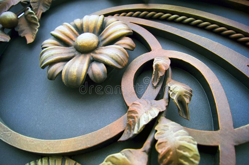 Forged flowers and other metal gate decorations royalty free stock photography
