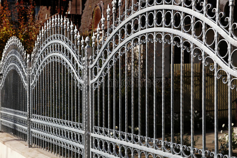 Forged iron fence stock images