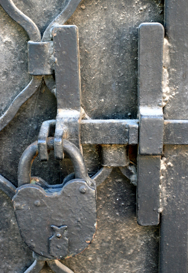 The forged iron lock. On a door royalty free stock photos