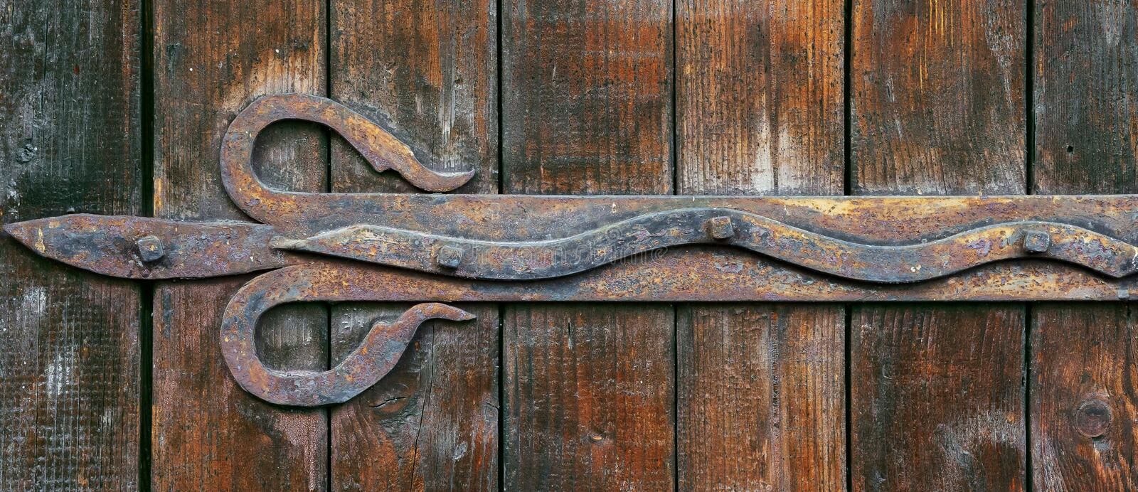 Forged metal elements on wooden doors stock photo