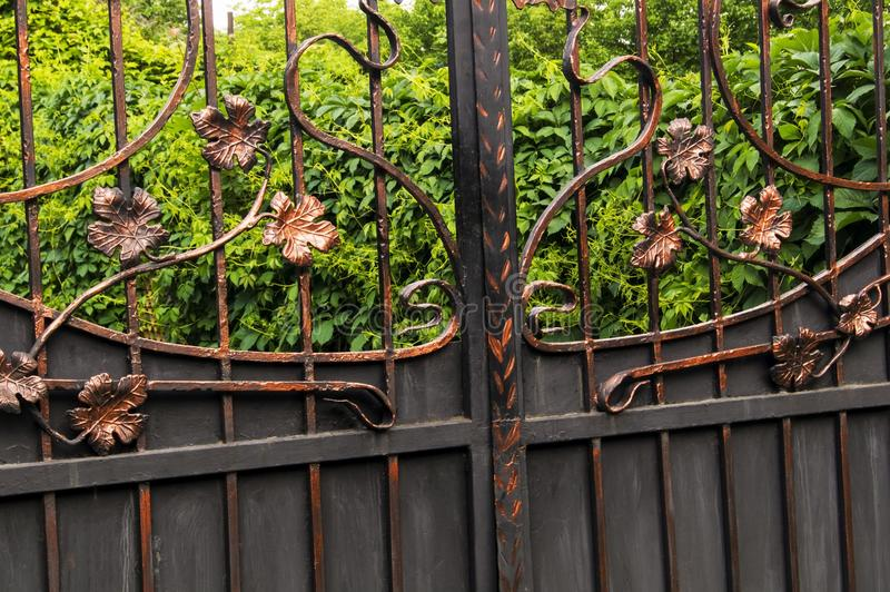 Metal gates decorated with forged elements royalty free stock photography