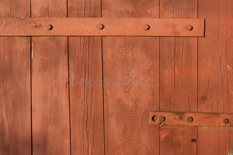 Forged metal hinge for gates and doors in the old style. Sharp curls of the iron door canopy are handmade by the blacksmith. Metal stock photo