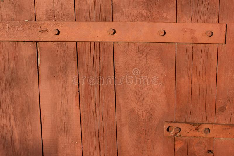 Forged metal hinge for gates and doors in the old style. Sharp curls of the iron door canopy are handmade by the blacksmith. Metal royalty free stock images