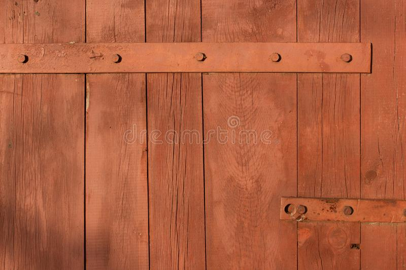 Forged metal hinge for gates and doors in the old style. Sharp curls of the iron door canopy are handmade by the blacksmith. Metal stock image