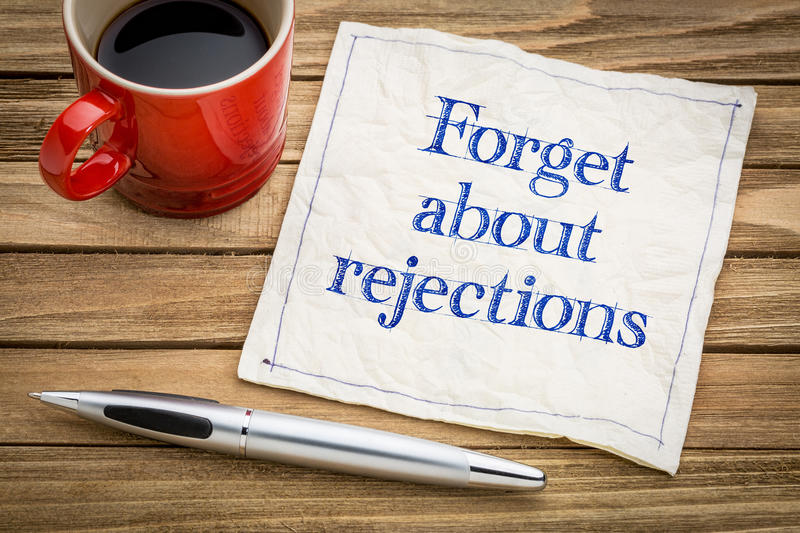 Forget about rejections - napkin concept. Forget about rejections advice - handwriting on a napkin with a cup of coffee royalty free stock image
