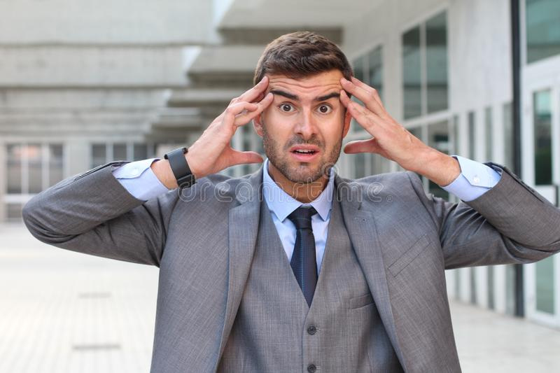Forgetful businessman realizing a major mistake stock photos