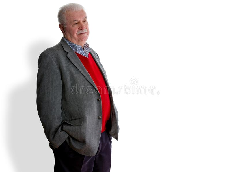 Forgetful elderly man standing thinking royalty free stock images