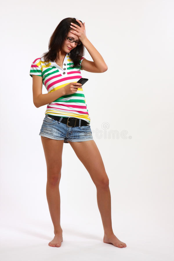 Forgetful teenager. Nice brunette teenager forget something royalty free stock photos