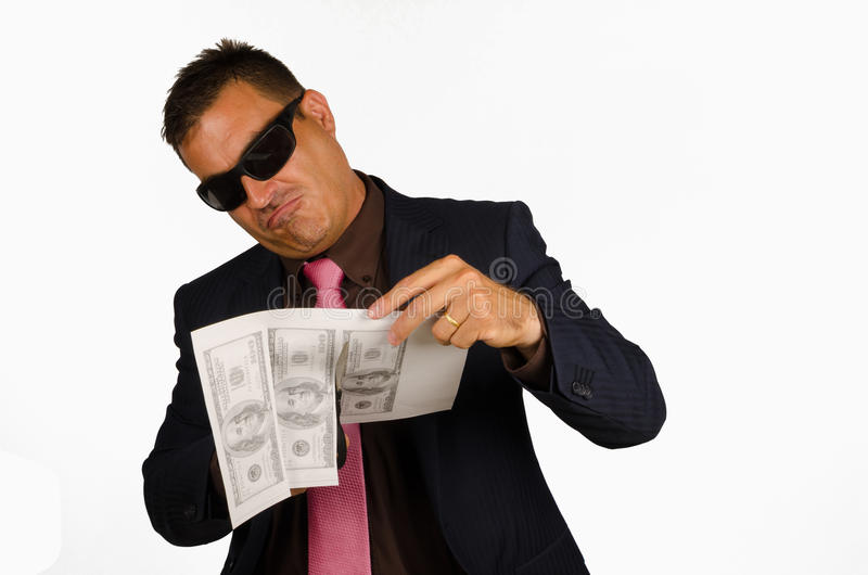 Forging money. Mafia type of guy forging money, a concept royalty free stock photography