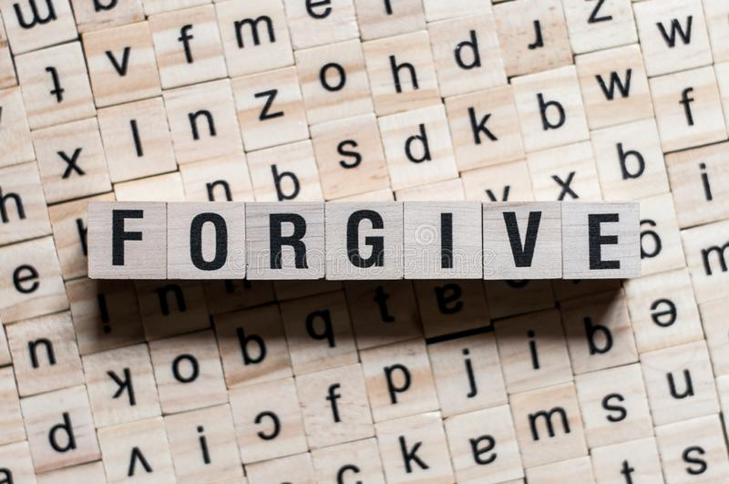 Forgive word concept. On cubes stock images