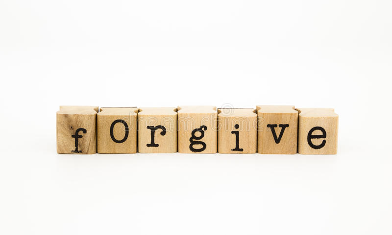 Forgive wording, ethic and merit concept. Closeup forgive wording isolate on white background, ethic and merit concept and idea royalty free stock photo
