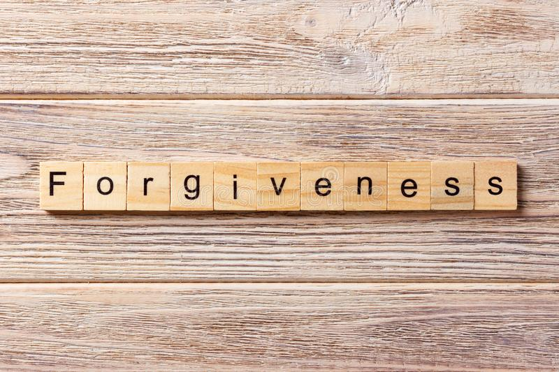 Forgiveness word written on wood block. forgiveness text on table, concept.  royalty free stock photography