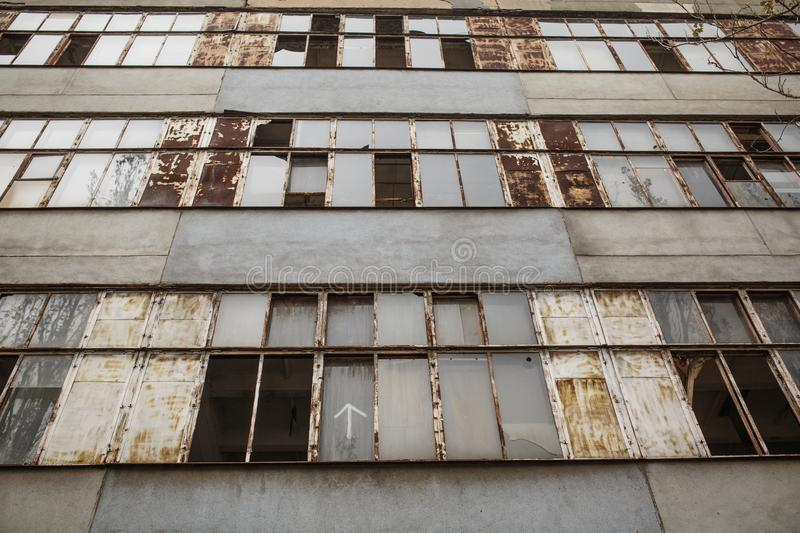 forgotten building with broken windows royalty free stock images