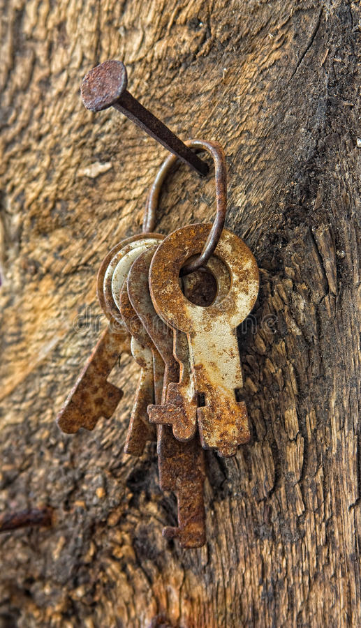 Forgotten keys on an old nail stock photography