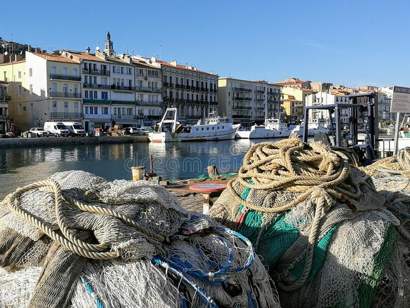Forground of two piles of fishing nets on the canal of the city of Sète in France- royalty free stock photography